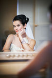 Beautiful bride sitting near mirror Royalty Free Stock Photos