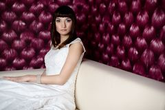 Beautiful bride sitting on the sofa Stock Photography