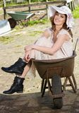Beautiful Bride Sitting in Wheelbarrow stock photos