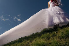 Beautiful bride on the sky background Stock Photo
