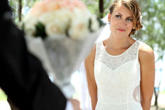Beautiful bride smile and looking to her groom Stock Images
