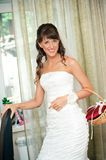 Beautiful bride smiles and looks in camera Royalty Free Stock Photos