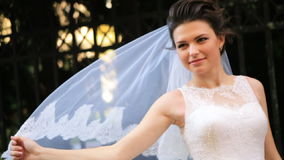 Beautiful bride smiling at camera shot in slow stock video footage