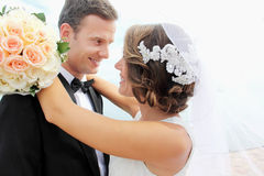 Beautiful bride smiling and embracing her groom Royalty Free Stock Photo