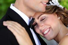 Beautiful bride smiling while eyes closed Stock Image