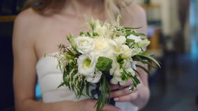 Beautiful bride sniffing the flowers close up stock video