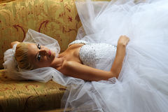 Beautiful bride on sofa Royalty Free Stock Images