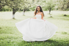 Beautiful bride spinning with perfect dress in the park Royalty Free Stock Images