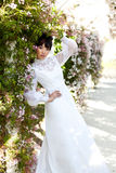 Beautiful Bride in Springtime. Beautiful Asian Bride in Springtime Royalty Free Stock Image