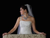 Beautiful Bride Standing Behind Chair Stock Photo