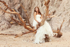 Beautiful bride. Standing on branches Royalty Free Stock Image