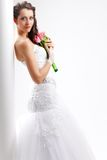Beautiful bride standing near white column Stock Photography
