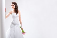 Beautiful bride standing near white column Royalty Free Stock Images