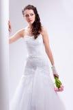 Beautiful bride standing near white column Stock Photo