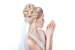 Beautiful bride is standing sideways. Royalty Free Stock Photo