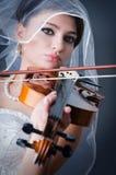Beautiful bride in studio. Shooting Royalty Free Stock Photo
