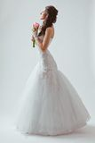 Beautiful bride studio full length portrait. With backlight Royalty Free Stock Images