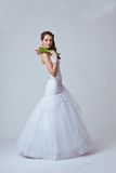 Beautiful bride studio full length portrait. Beautiful bride holding bouquet studio full length portrait Stock Photography