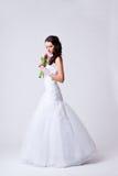 Beautiful bride studio full length portrait. Beautiful bride holding bouquet studio full length portrait Stock Image