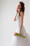 Beautiful bride studio half-length portrait. Beautiful bride studio portrait with backlight, she closed her eyes Royalty Free Stock Images