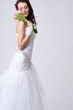 Beautiful bride studio portrait. Beautiful bride holding bouquet on shoulder studio portrait and closed her eyes Stock Photos