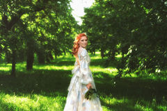 Beautiful bride in summer colorful park. Girl in vintage dress. Royalty Free Stock Image