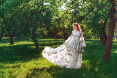 Beautiful bride in summer green park. Girl in vintage dress. Stock Photo