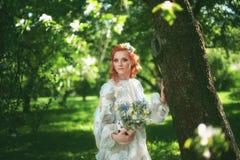 Beautiful bride in summer park. Girl in vintage dress. Stock Photo