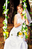 The beautiful bride on a swing Stock Photo