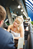 Beautiful Bride at table in cafe royalty free stock image
