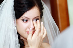 Beautiful bride tears Stock Photography