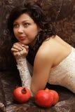 Beautiful bride with three pomegranates Stock Image