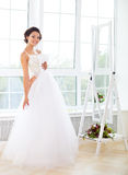 Beautiful bride-to-be trying her dress in shop Royalty Free Stock Image