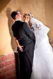 Beautiful bride touching grooms butt and smiling Royalty Free Stock Photography