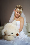 Beautiful bride with toy bear in wedding day Stock Image