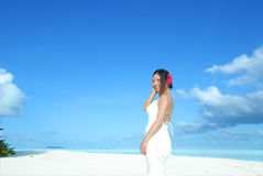 Beautiful bride on tropical beach Stock Photography