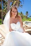 Beautiful bride on tropical beach Royalty Free Stock Photo