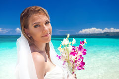 Beautiful bride on tropical beach Stock Photo