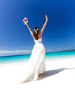Beautiful bride on tropical beach Stock Images