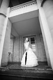 Beautiful Bride with umbrella at entrance of palac Royalty Free Stock Images