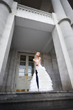 Beautiful Bride with umbrella at entrance of palac Royalty Free Stock Photos