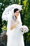 Beautiful bride umbrella Stock Image