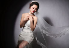 Beautiful bride. Under the spotlight of the bride with a slightly shy stock photo