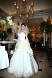 Beautiful bride in unusual wedding dress in the restaurant Royalty Free Stock Photography
