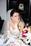 Beautiful bride in unusual wedding dress in the restaurant Royalty Free Stock Photos