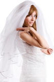 Beautiful bride with veil. Over white Royalty Free Stock Images