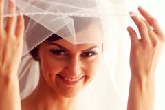 Beautiful bride with veil in her room Stock Photography