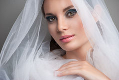 Beautiful bride with veil over her face Royalty Free Stock Photos