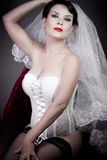 Beautiful bride with veil and white corset Stock Photography