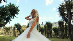Beautiful bride on the walk stock video